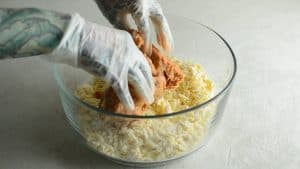 Mixing ground pork sausage into the cheese and flour mixture