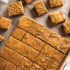 Squares of peanut butter fudge arranged on a tray